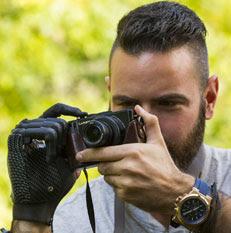 Man holding camera with i-digit prosthetic hand